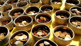 Merit coins. Coins for merit in buddhism Stock Photography