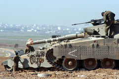 Merkava Tank. NACHAL OZ- NOV 26:IDF soldiers perform maintenance to their Merkava Tank with Gaza Strip in the background on NOV 26 2007.It designed to endure Royalty Free Stock Photos