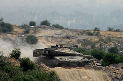 Merkava Tank. ZIKIM,ISR - JUNE 19:Merkava Tanks on June 19 2007. The Mark IV has the Israeli-designed TSAWS system, It designed to endure the harsh basalt rock Royalty Free Stock Image