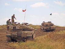 Merkava tanks and Israeli soldiers in training armored forces. Golan Heights, Israel - January 13, 2012: Merkava tanks and Israeli soldiers in training armored Stock Images