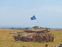 Merkava tanks and Israeli soldiers in training armored forces. Golan Heights, Israel - January 13, 2012: Merkava tanks and Israeli soldiers in training armored Royalty Free Stock Photo