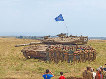 Merkava tanks and Israeli soldiers in training armored forces. Golan Heights, Israel - January 13, 2012: Merkava tanks and Israeli soldiers in training armored Stock Photography