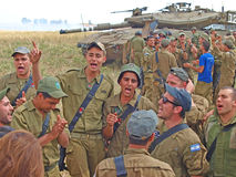 Merkava tanks and Israeli soldiers in training armored forces. Golan Heights, Israel - January 13, 2012: Merkava tanks and Israeli soldiers in training armored Royalty Free Stock Image