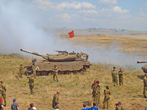Merkava tanks and Israeli soldiers in training armored forces Royalty Free Stock Images