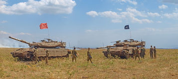 Merkava tanks and Israeli soldiers in training armored forces Royalty Free Stock Photos