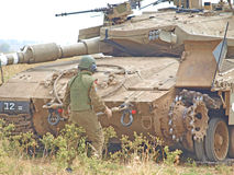 Merkava tanks and Israeli soldiers in training armored forces. Golan Heights, Israel - January 13, 2012: Merkava tanks and Israeli soldiers in training armored Royalty Free Stock Photos