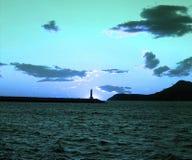 Merkwürdiger Sonnenuntergang in dem Meer Stockbild