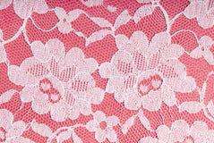 Merletto bianco sul colore rosa Fotografia Stock