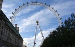 The merlin entertainments london eye. (commonly the london eye, or millennium wheel, formerly the british airways london eye) is a giant 135-metre (443 ft) tall Stock Image