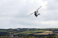 Merlin Flying de hemel boven Portrush Stock Afbeelding
