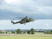 Merlin Helicopter. Hovering near the ground in Somerset, England Royalty Free Stock Photography