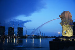 Merlion. A symbolic statue or sculpture in Singapore. Background is the under construction IR, one of the casino Stock Images