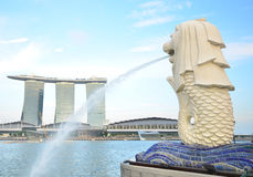 Merlion in cielo blu Fotografia Stock