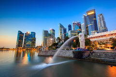 The Merlion fountain Singapore skyline. SINGAPORE-DEC 16, 2014: Merlion statue fountain in Merlion Park and Singapore city skyline on December 16, 2014. This royalty free stock image