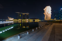 The Merlion fountain and Singapore skyline by night. Merlion is Royalty Free Stock Photo