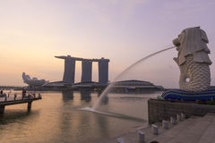 The Merlion fountain spouts water in front of Marina Bay Sand Stock Image