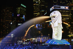 The Merlion fountain spouts water in front of the One Fullerton Royalty Free Stock Photography