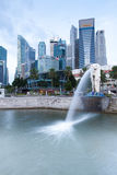 Merlion fountain, the symbol of Singapore. Singapore, Singapore - July 17, 2013: famous Merlion fountain, the symbol of Singapore and Central business district royalty free stock photography