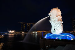 Merlion and Marina Bay Sands in Singapore on dusk Stock Image