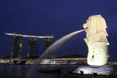 Merlion and Marina Bay Sands Singapore. Night scene of Merlion and Marina Bay Sands in Singapore and a boat in the bay Stock Images