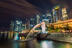 Merlion at night time , Singapore 16/10/2016. Waiting to light for more color stock images