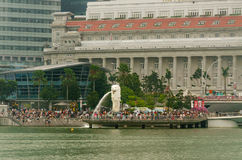 Merlion Park with tourist crowds. Merlion is the Singapore's national icon and the statue at the Merlion Park is a must-see tourist attraction while visiting Stock Photography