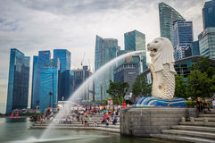 Merlion in Singapore Harbour. Merlion statue fountain at Singapore Harbour with skyline in background Royalty Free Stock Photos