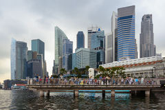Merlion and Singapore skycrapers Stock Photos