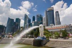 Merlion with Singapore skyline Stock Photo