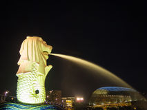 Merlion statue fountain and city skyline at night in singapore Royalty Free Stock Photo