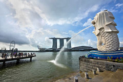 Merlion Statue and Marina Bay Sands Building in Singapore Royalty Free Stock Image