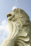 Merlion Statue at Sentosa Singapore. The Merlion is an icon representing Singapore.  It consist of a lion's head and a fish tail Royalty Free Stock Photo