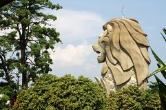 Merlion Statue at Sentosa Singapore. The Merlion consists of a lion's head and a fish tail Stock Photos