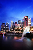 CBD and Merlion. Merlion statue in Singapore with Central Business District skyscrapers in the background in the evening Royalty Free Stock Image