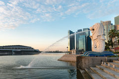 Merlion statue is a Singapore landmark. Singapore center with Merlion and skyscrapers at early morning Stock Photography