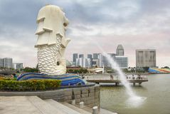 Singapore. Embankment. MERLION. The MERLION is the symbol of Singapore. MERLION is a sculpture on the waterfront, a mythical creature with a lion`s head and a Royalty Free Stock Photos