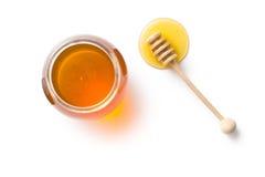 Merlo acquaiolo del miele e miele in barattolo Immagini Stock Libere da Diritti