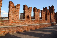 Merlons of old Castle in Verona, Italy. Merlons along the Scaligero bridge in the Old Castle of Verona, Italy Royalty Free Stock Photography