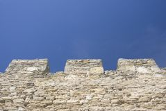 Merlons of an old fortress wall Royalty Free Stock Image