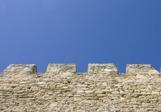 Merlons of an old fortress wall Stock Photography