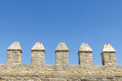 Merlons of an old fortress wall Royalty Free Stock Images