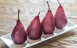 Merlot-tjuvjagade päron på plattan Fotografering för Bildbyråer
