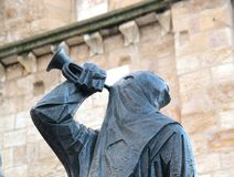 Hooded statue by the cathedral in central Zamora Spain royalty free stock images
