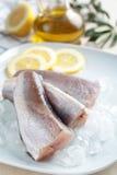 Merluches crues Photographie stock libre de droits