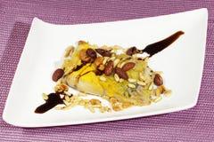 Merluches cuites au four avec des écrous Photo libre de droits