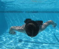 Mermaid Approach. An underwater view of a swimming young girl Stock Photography