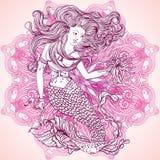 Mermaid with beautiful hair and marine plants over ornate mandala round pattern. Tattoo art. Stock Photos