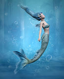 Mermaid. Beautiful mermaid swims in a blue sea Royalty Free Stock Photography