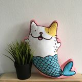Mermaid Cat Pillow Beside Plant Royalty Free Stock Photography
