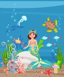 Mermaid and coral reef Stock Images